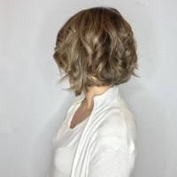 short and curly haircut with style